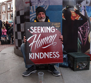 Kenji Nakayama and Christopher Hope began Signs for the Homeless in an attempt to use the striking impact of beautifully lettered signs, as replacement for dilapidated placards held by the homeless in Boston, to make passers-by stop and take notice.